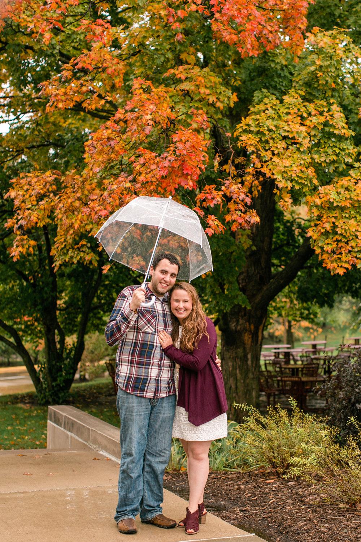 fall engagement photos university of northern Iowa cedar falls rainy day on campus