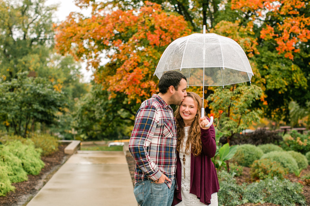 des moines engagement locations fall iowa rainy sunny umbrella kissing