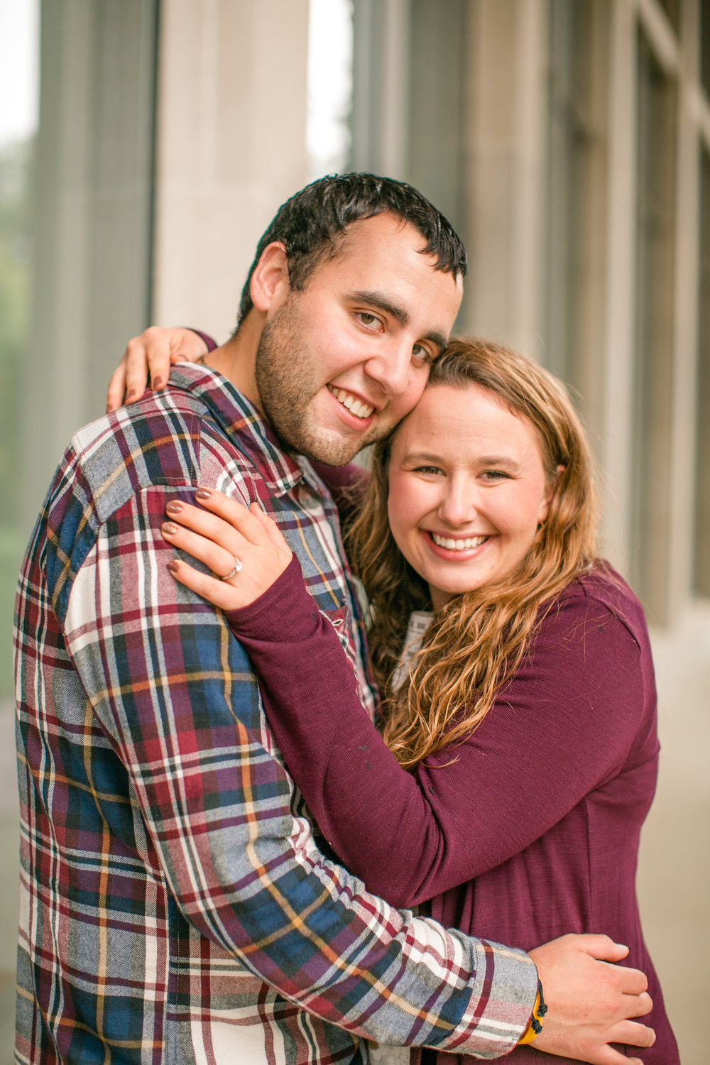 fall engagement photos what to wear maroon cardigan over white dress