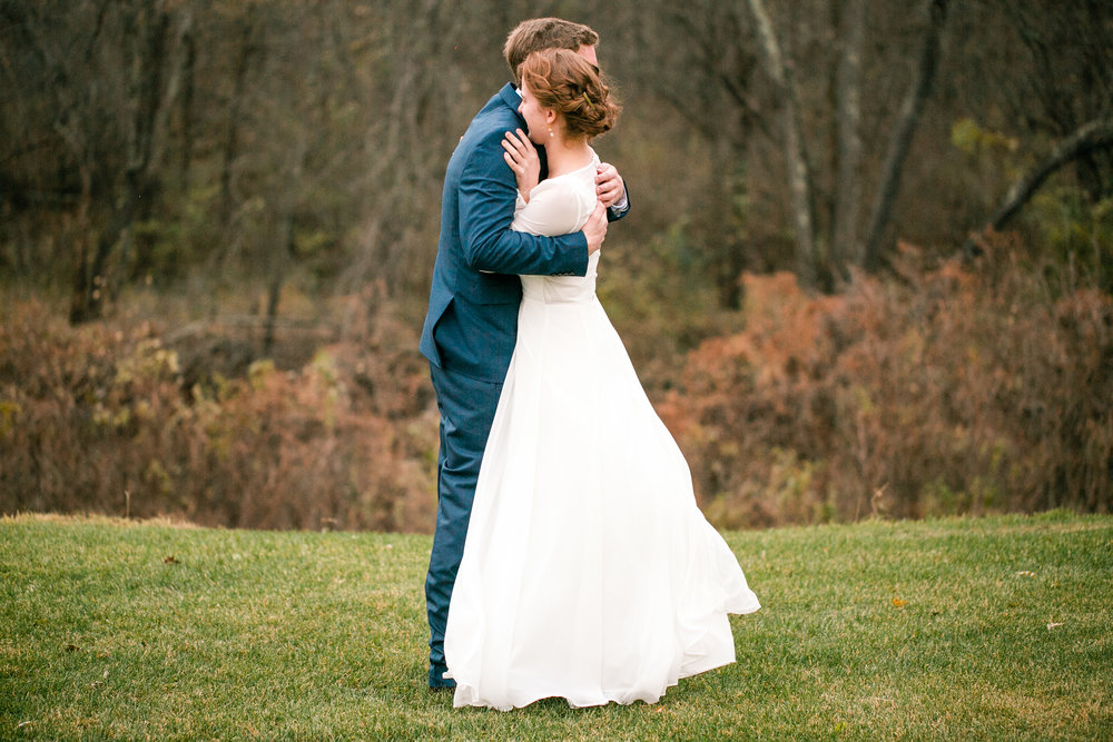 magical moment bride's dress caught in wind outdoor wedding wisconsin