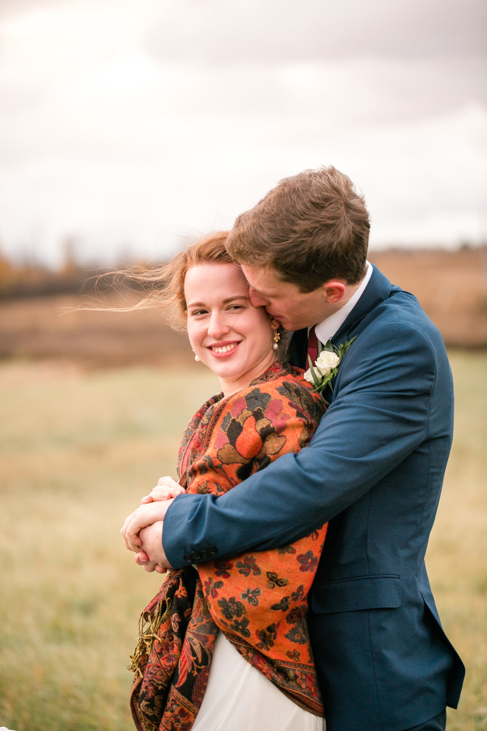 best affordable wedding photographers in Minneapolis fall and winter weddings candid moments between bride and groom