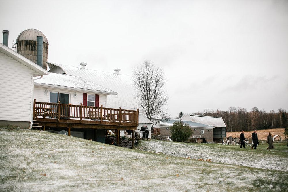 outdoor winter farm wedding in Wisconsin snow