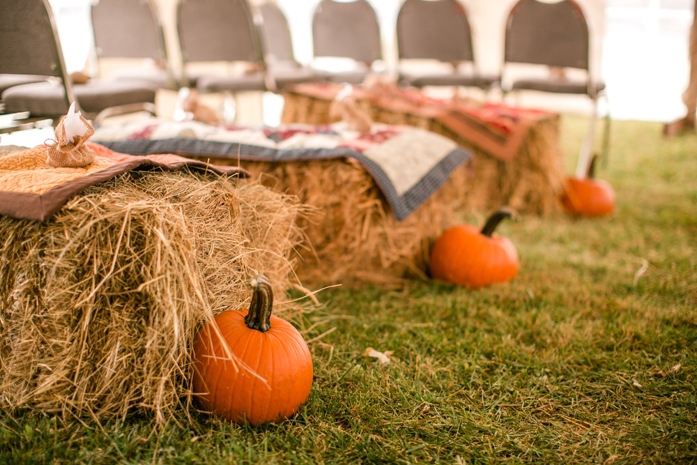 pumpkins hay bales and quilts wedding decor