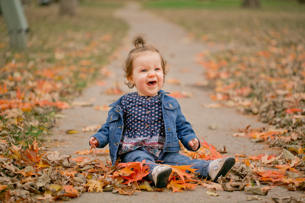 cute little girl one year old photos in the fall family photographers in des moines iowa