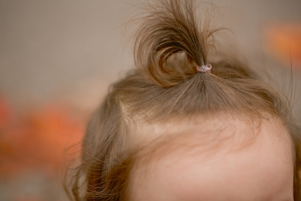 little girl pigtail baby photos at home lifestyle photographers in des moines