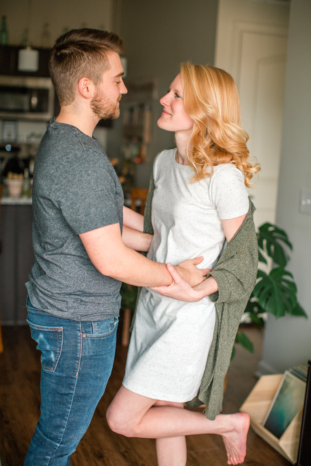 the sweetest couple celebrating one year of marriage at home in lifestyle intimate photos