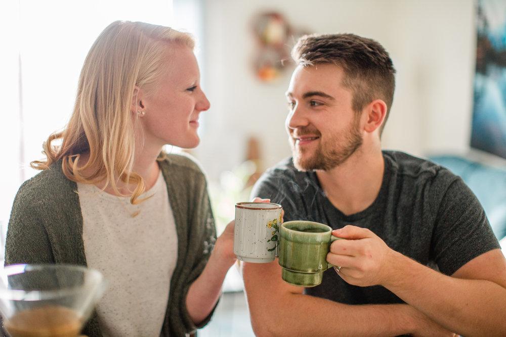 cheers with coffee mugs anniversary photos