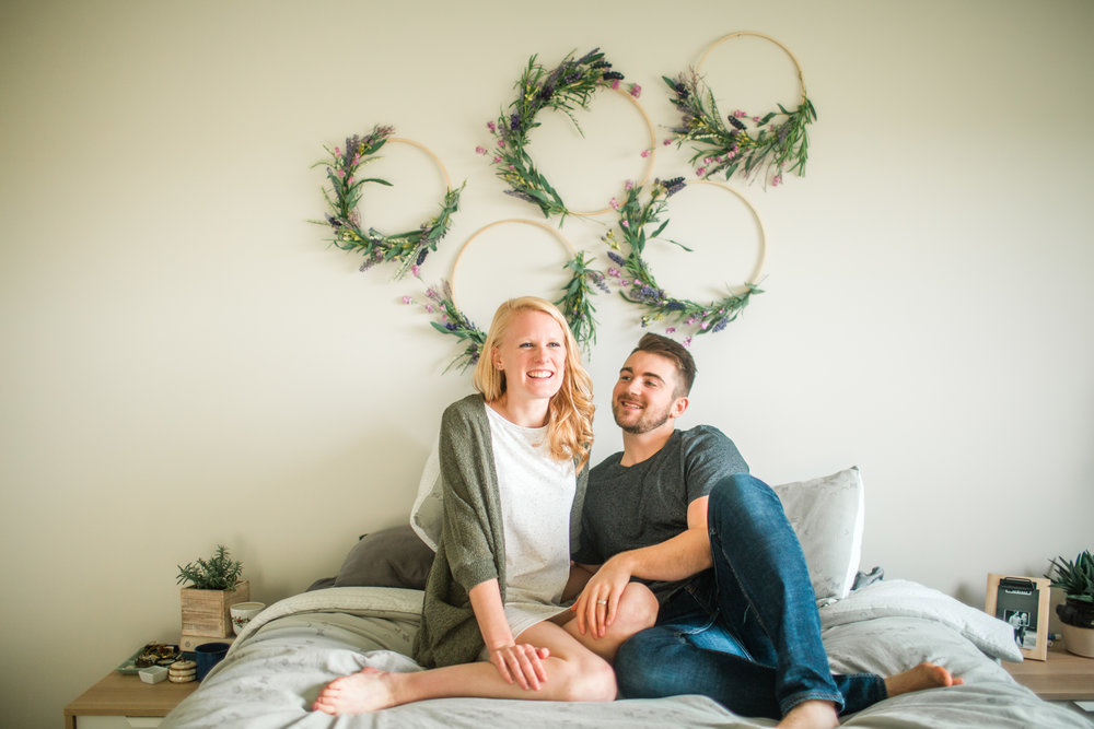 cute couple intimate engagement photos in home des moines