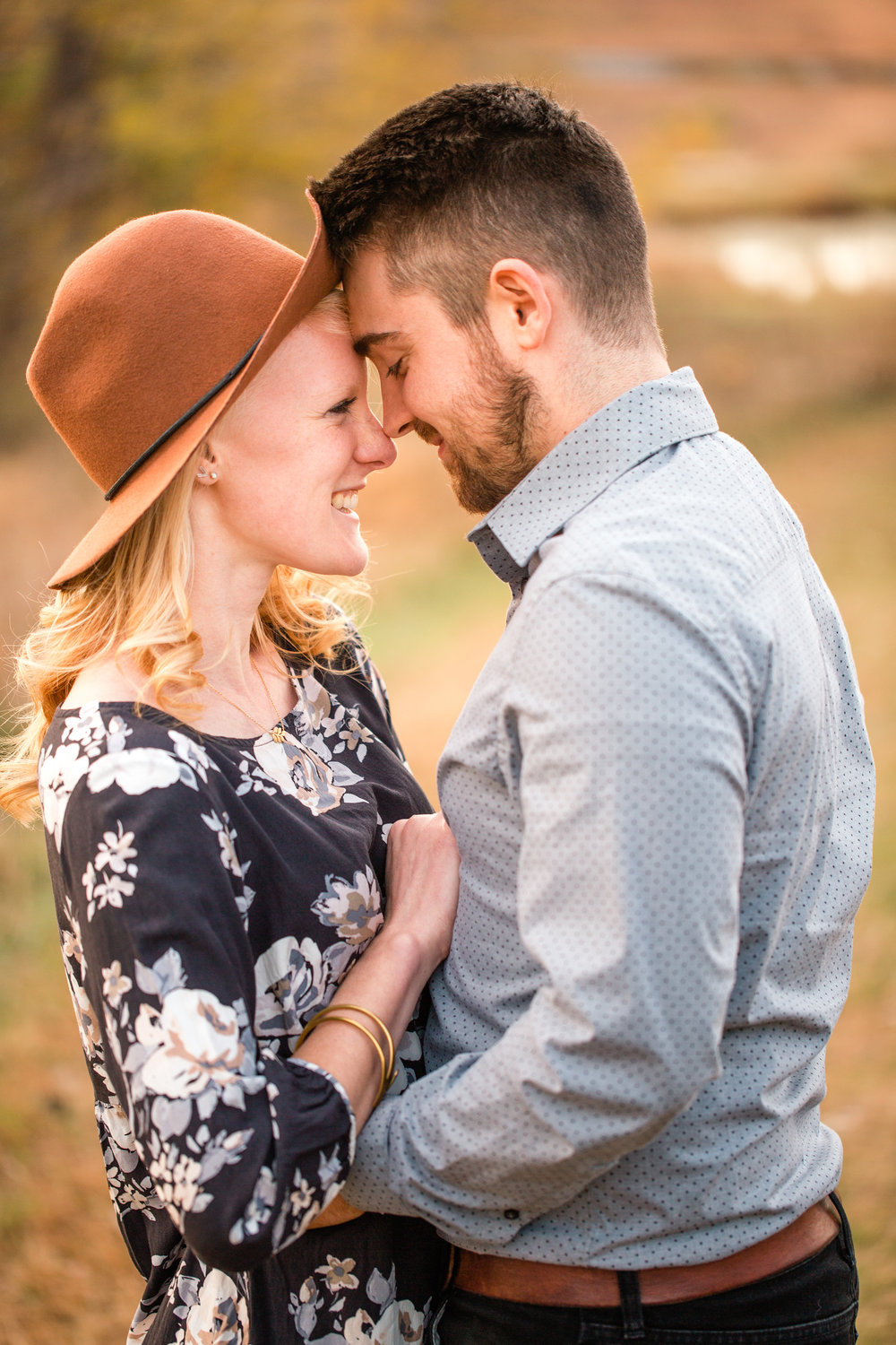 couple first wedding anniversary pictures in park in fall wearing nice outfits cute hat