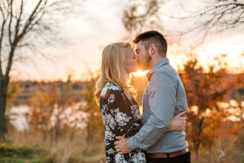 couple_kissing_sunset_fall_engagement_photos_des_moines.jpg