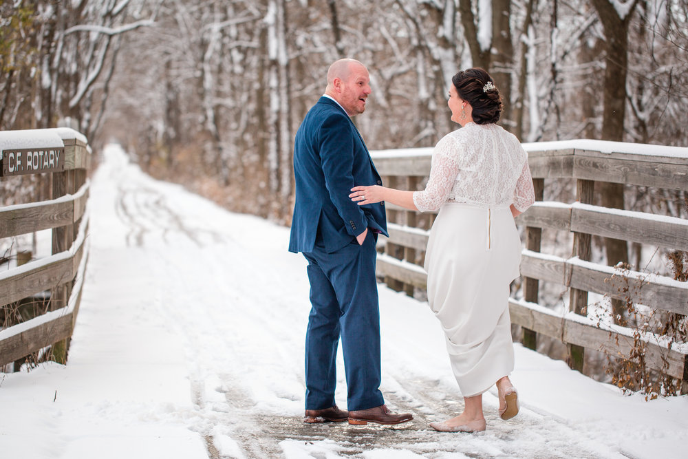 first look on snowy bride winter wedding photographers in Iowa des moines and cedar falls