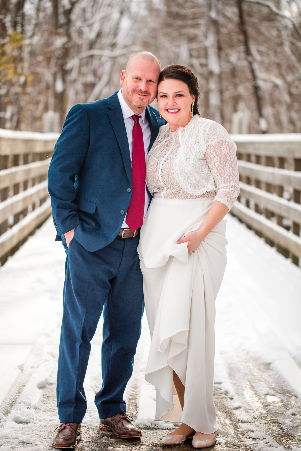wintery wedding in Des Moines Iowa bridge first look photos Kirsten Mike