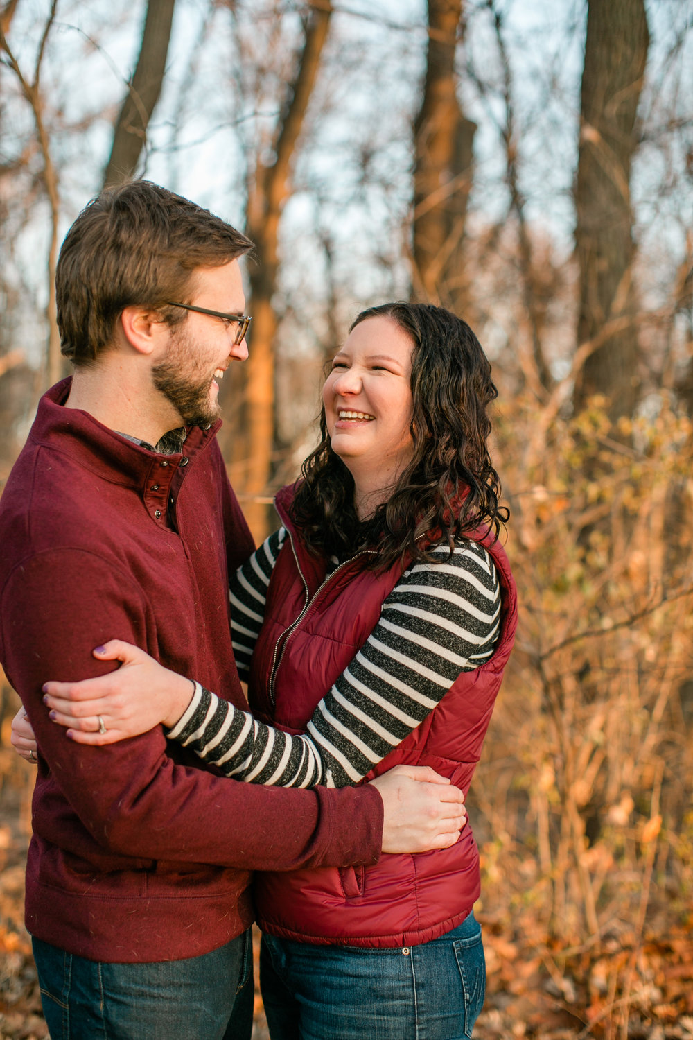 cute couple engagement photos with dog De Moines Ankeny area wedding photographers