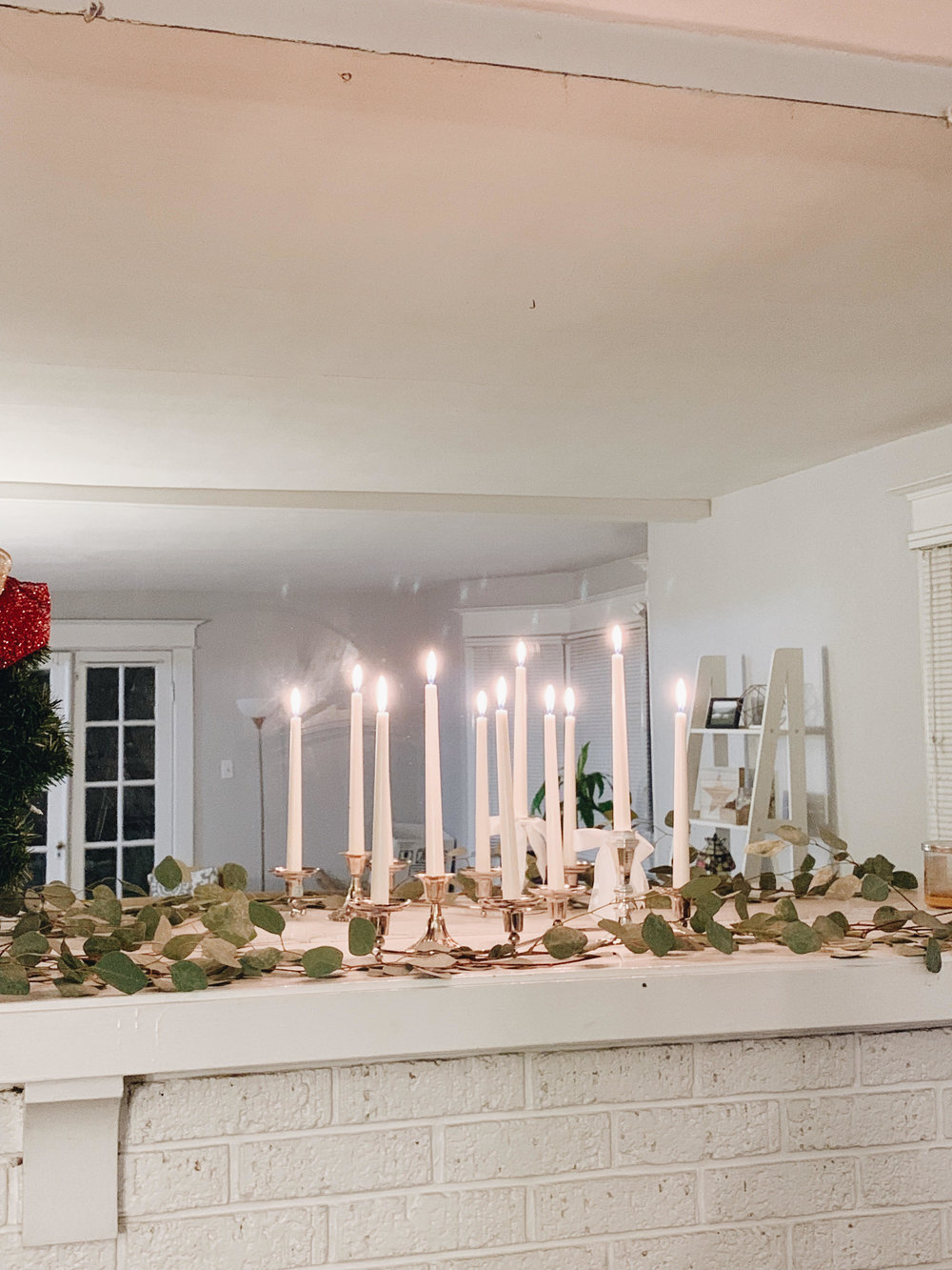 cute christmas decorations des moiens homes Iowa candles and greenery on mantle