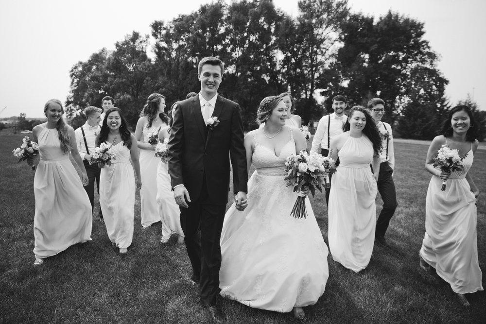 bridal party in des moines park celebrating wedding