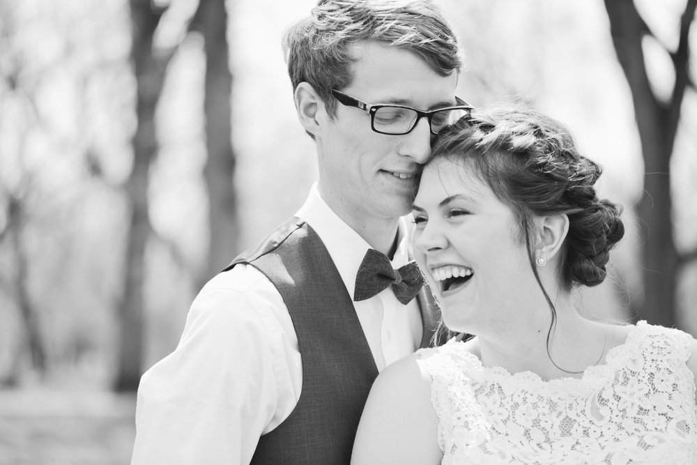 laughing bride and groom wedding photos Des Moines Iowa