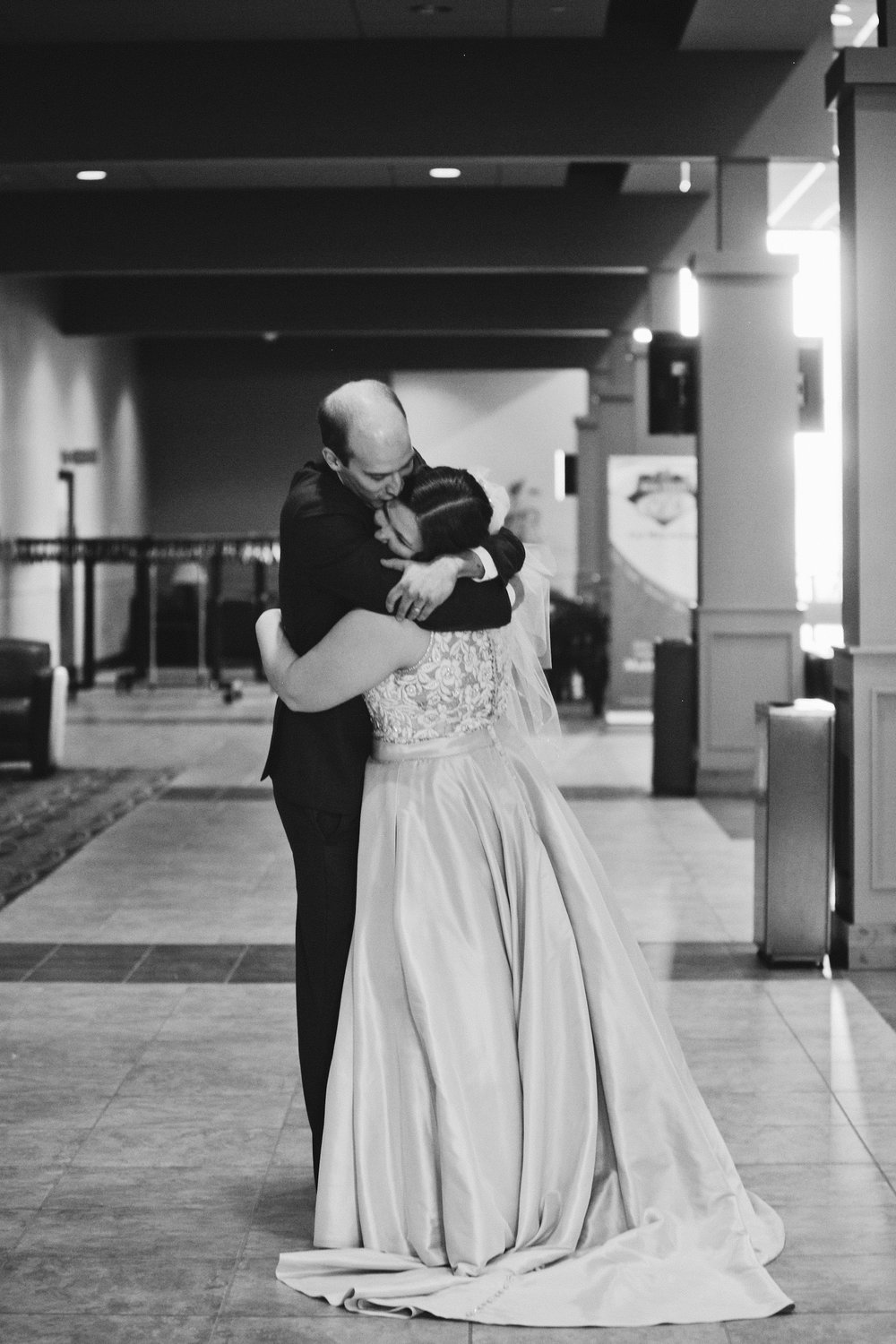 bride and groom hugging right after the wedding ceremony