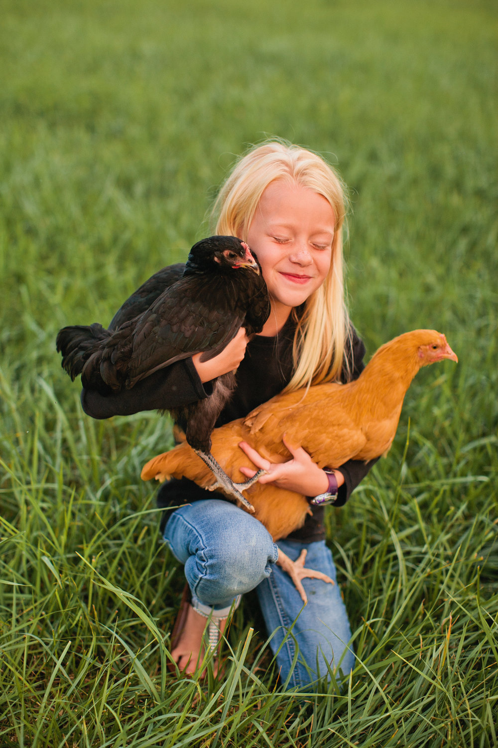 portrait of a young girl in backyard with chicken lifestyle family photos des moines