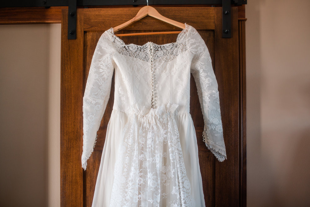 bride wearing grandmother's vintage wedding dress lace