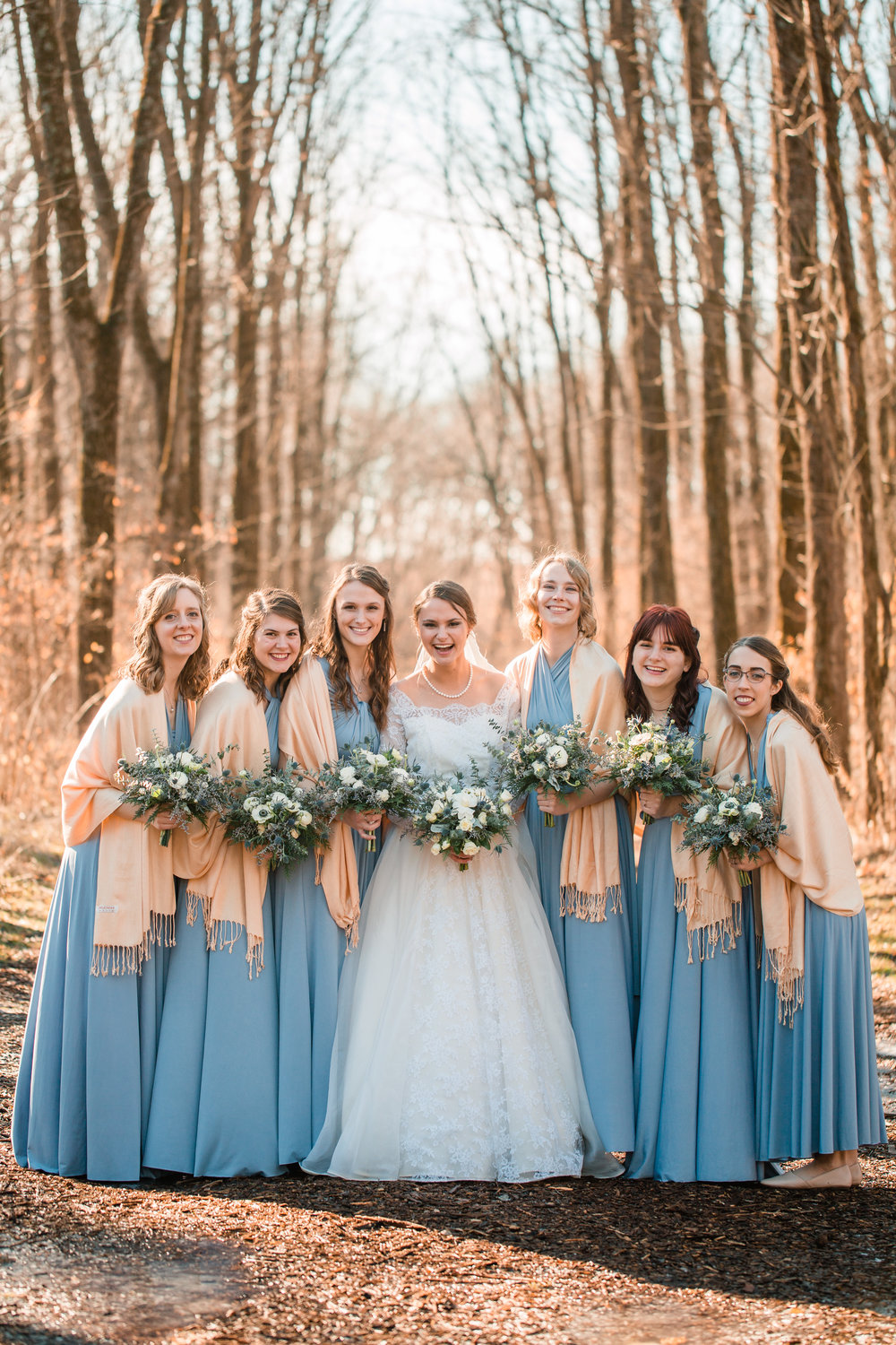gorgeous wedding bride and bridesmaids in dusty blue iowa city wedding photos