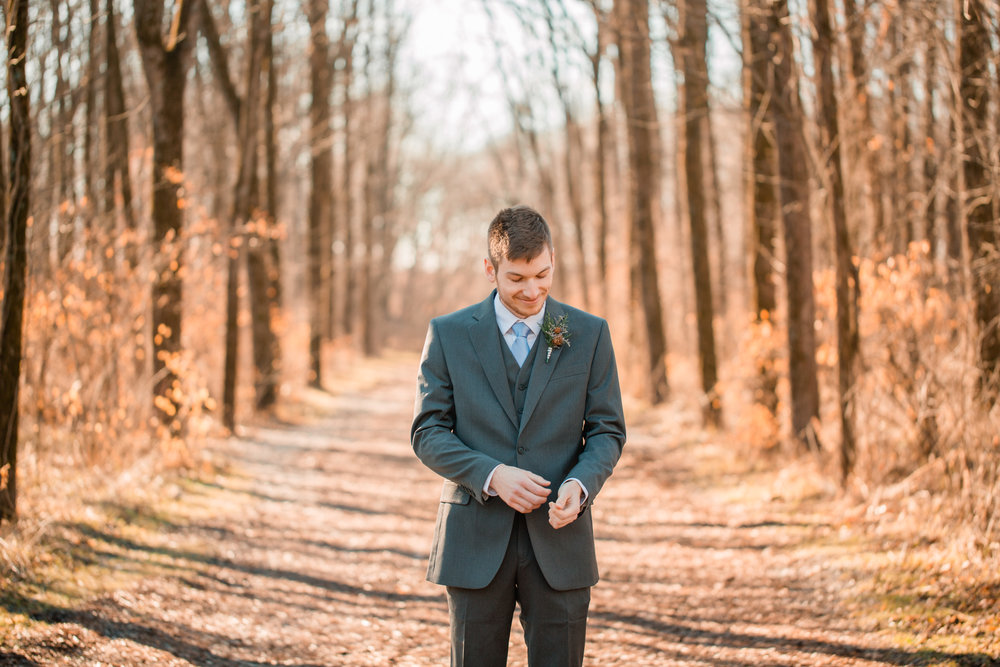 groom portraits in woods Iowa City