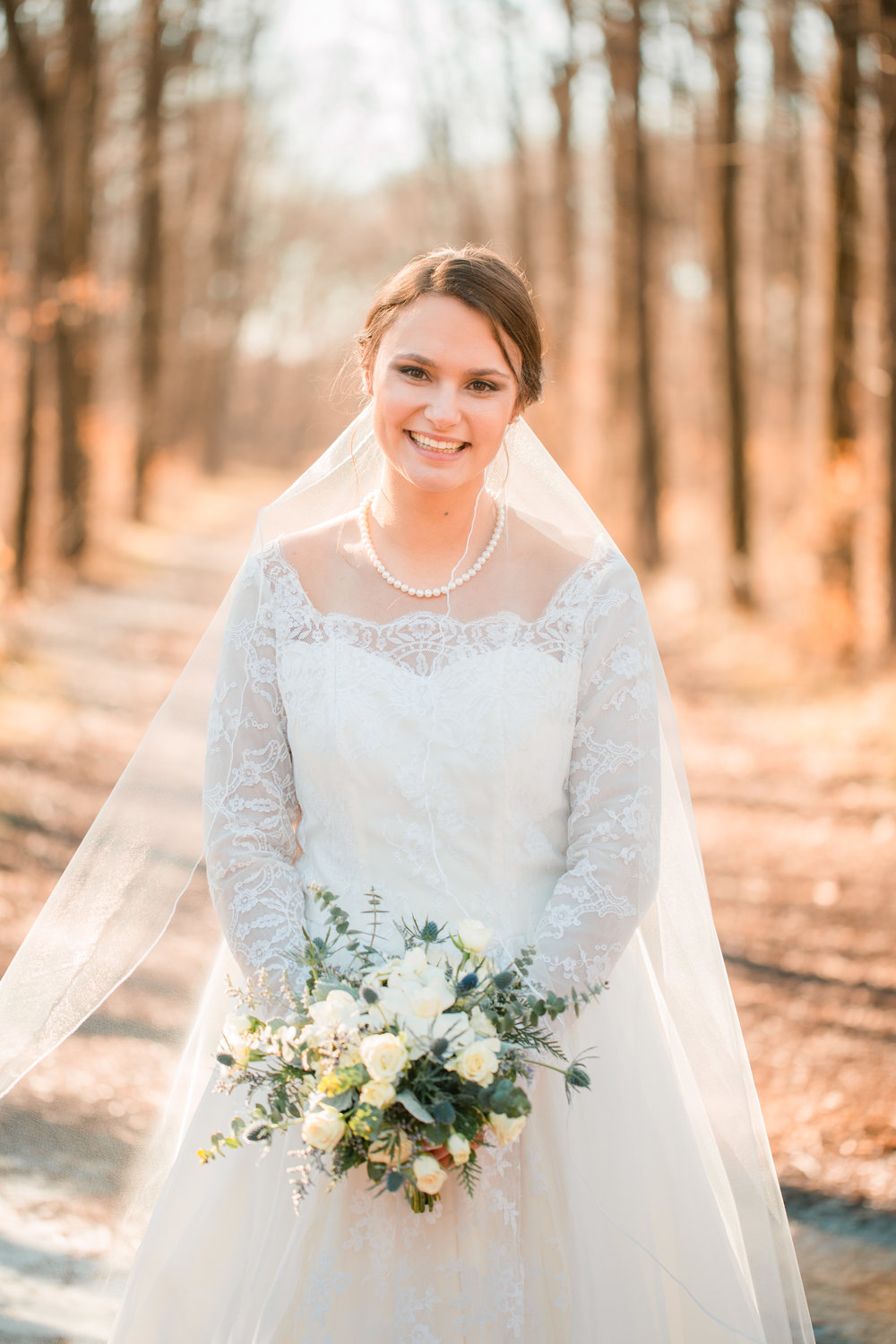 bridal portraits in woods natural photos long veil and lace vintage dress