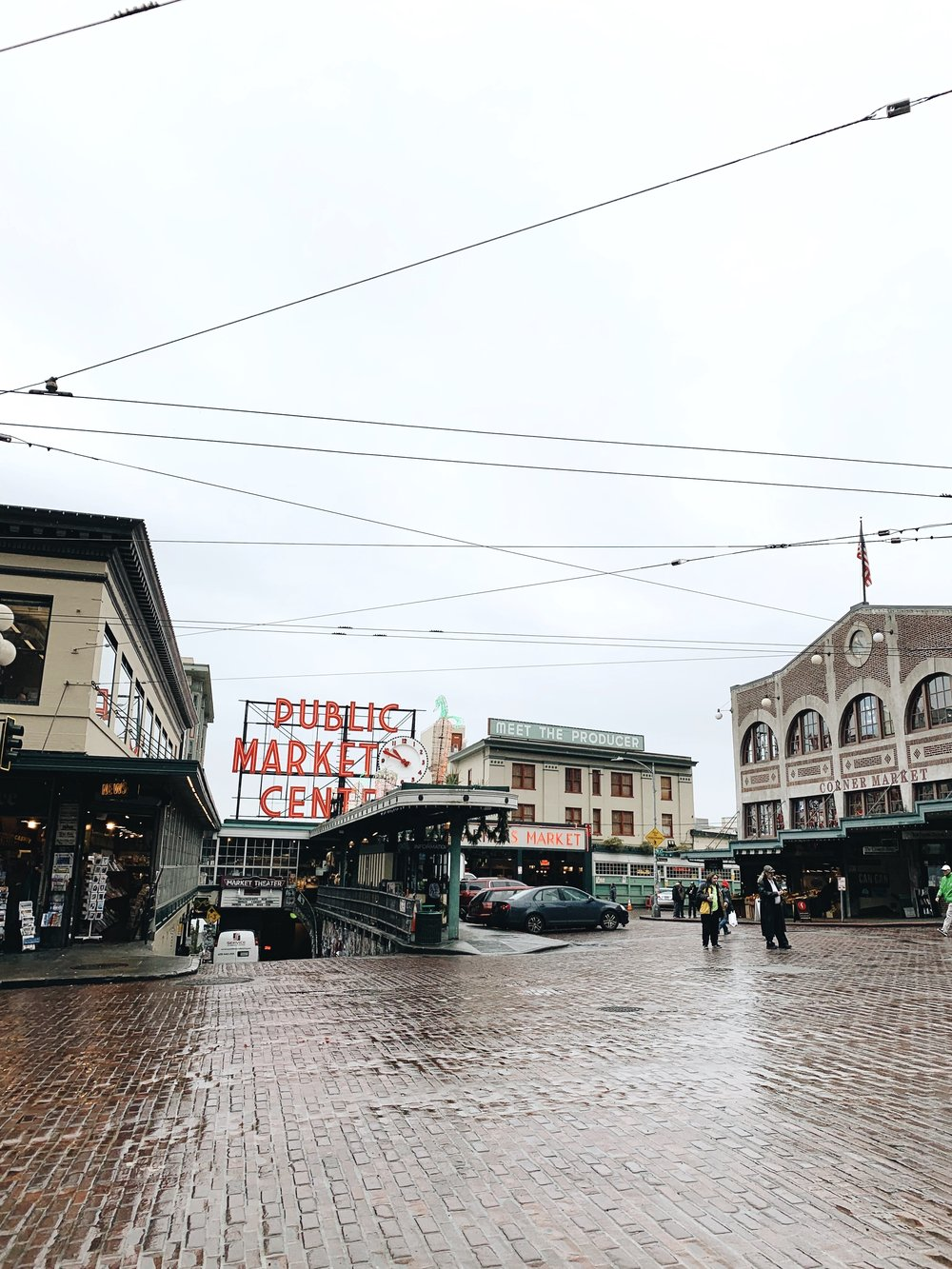 rainy day at pike place market in downtown seattle