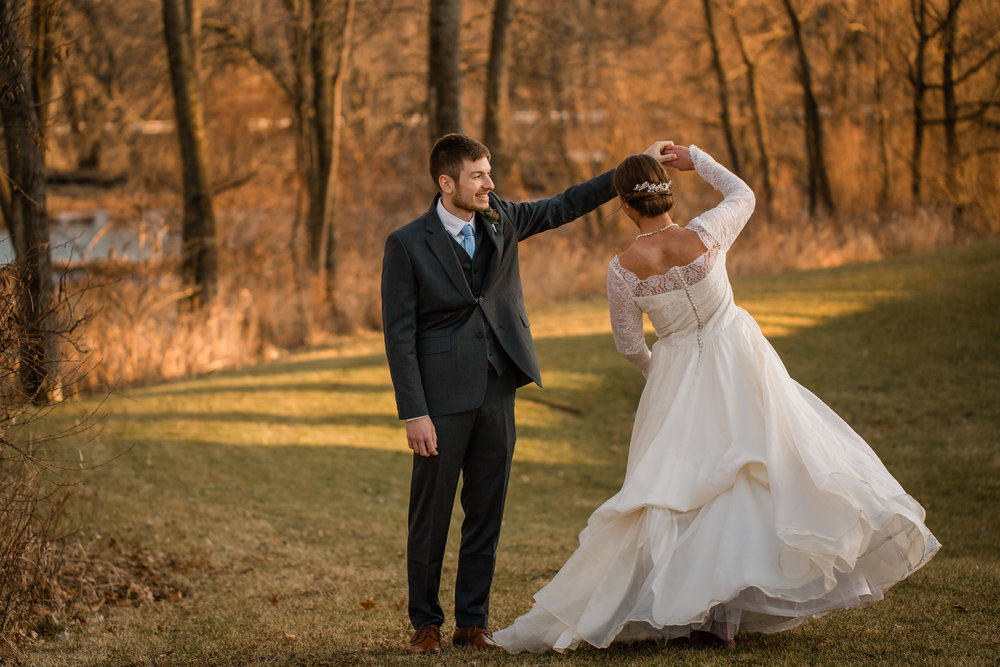 romantic wedding photos bride twirling in vintage wedding dress