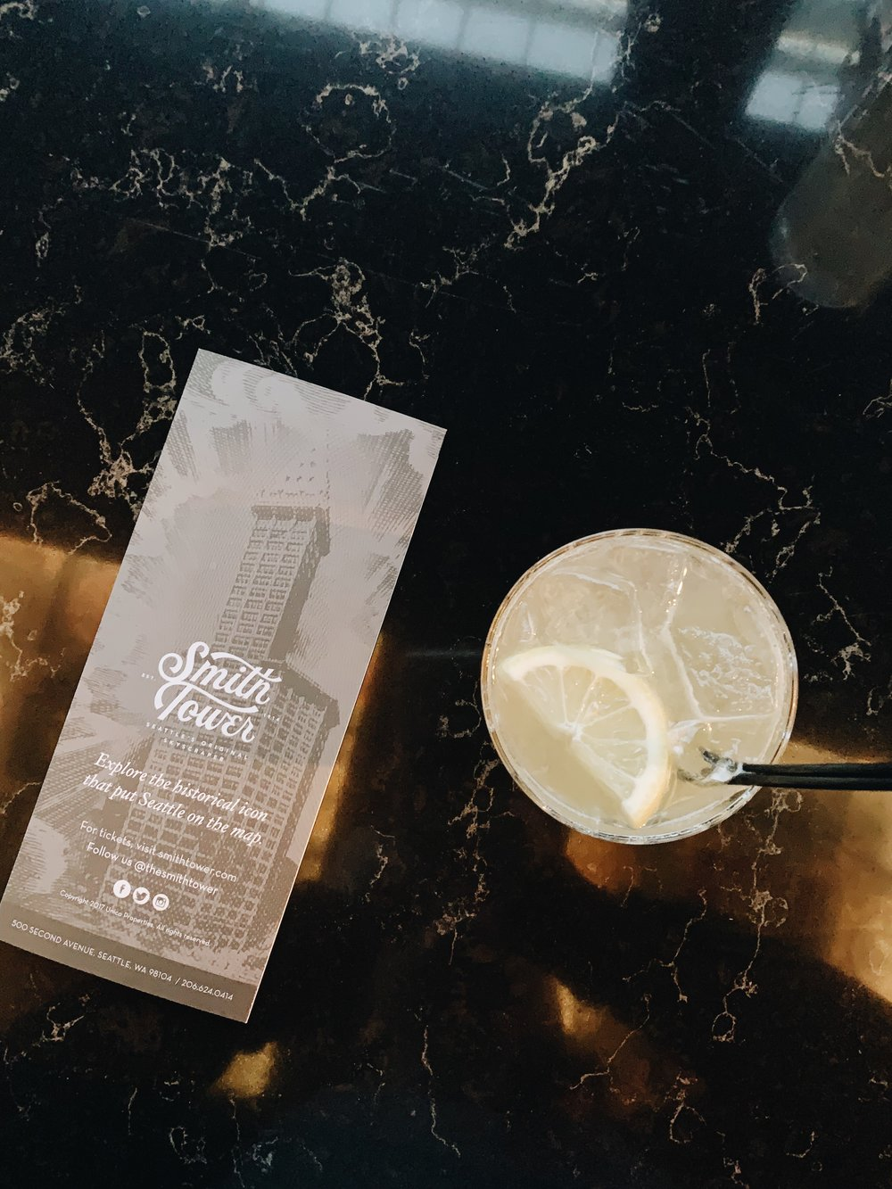 get the gold rush! it's a tasty burbon cocktail for happy hour drinks at smith tower in downtown seattle