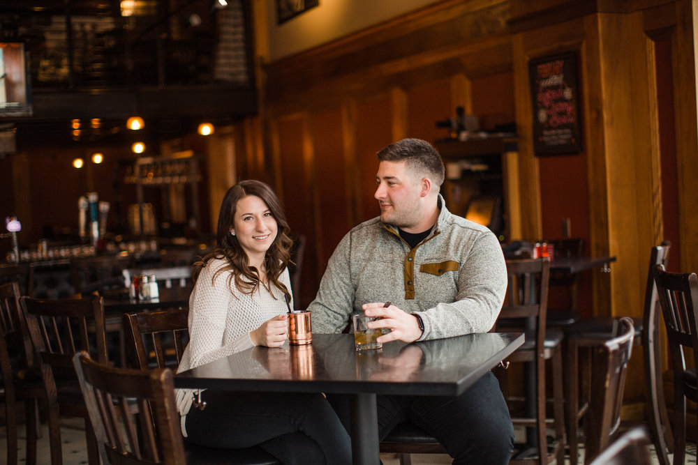 Des Moines engagement photos downtown in a bar