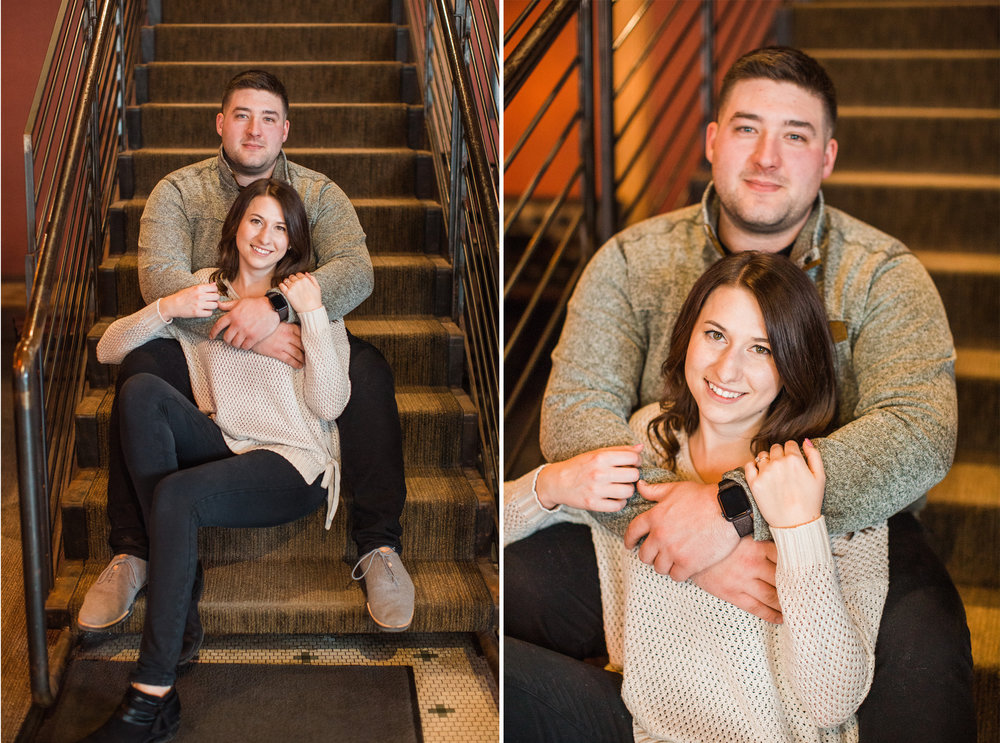 couple sitting on step in Americana Des Moines restaurant