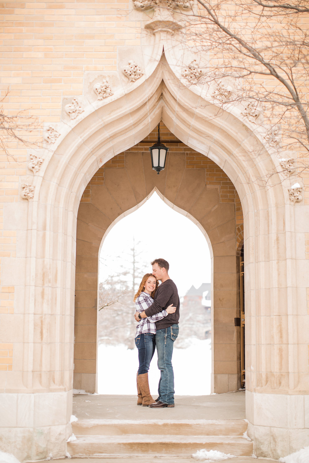 winter snowy engagement pictures on campus ideas