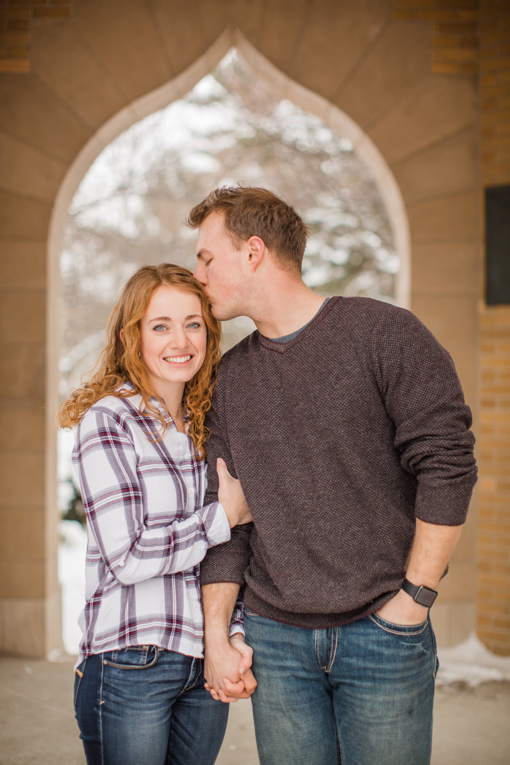 winter engagement photos guy kissing finace with red hair
