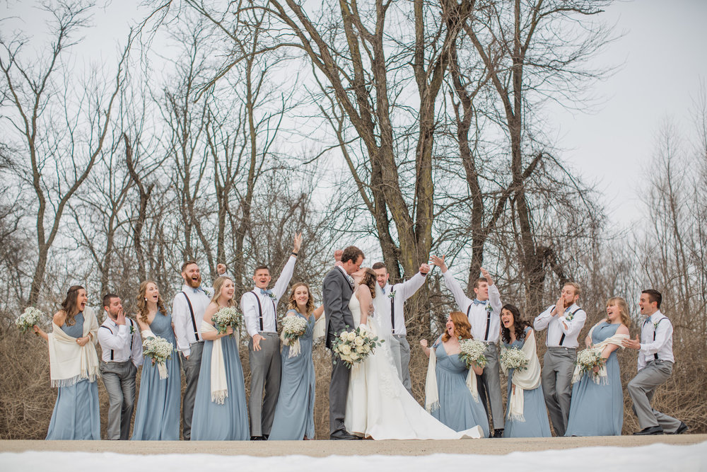 winter wedding photos of bridal party