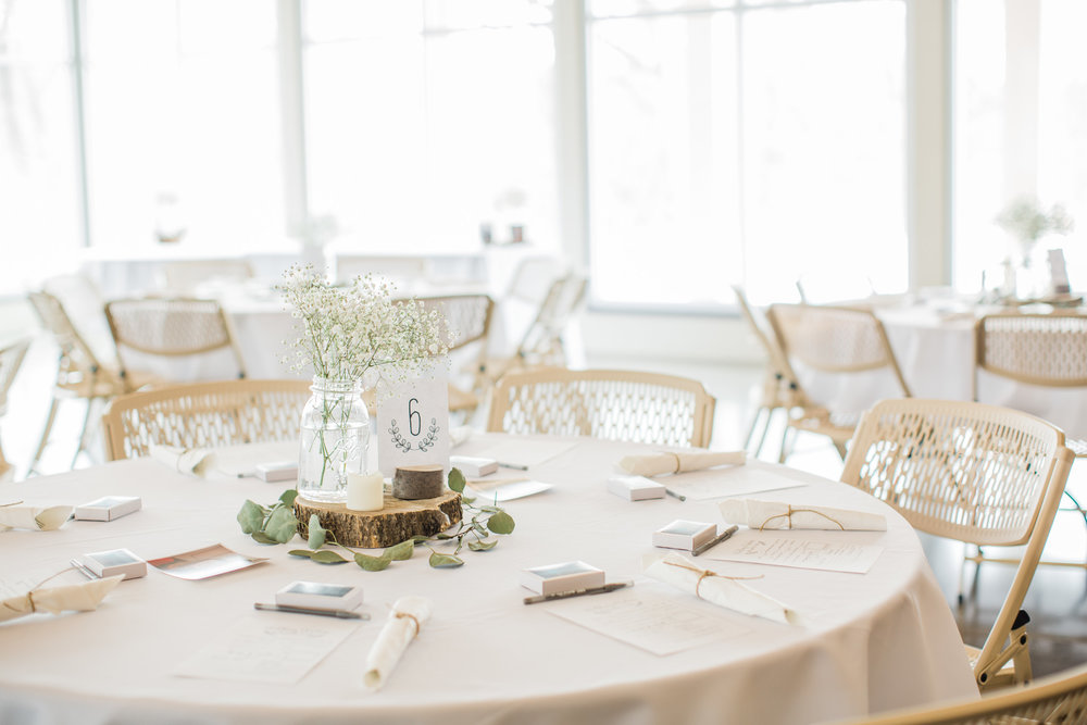wedding reception decor white and green with babys breath and eucalyptus