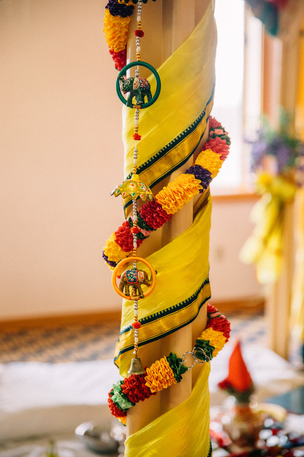 Hindu wedding decorations elephants and bells with bright colored sashes yellow and red