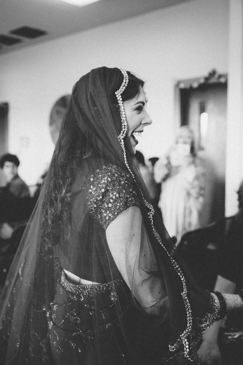 bride in saree walking down the aisle to her wedding ceremony des moines iowa wedding photographers