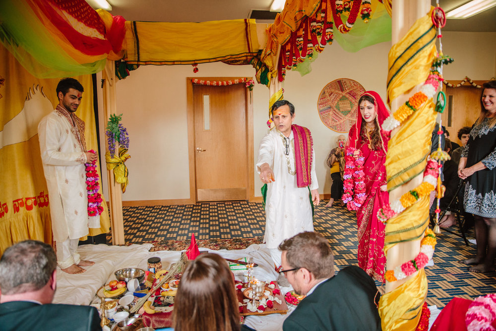 Hindu priest directing the bride and groom during wedding ceremony madrid iowa temple