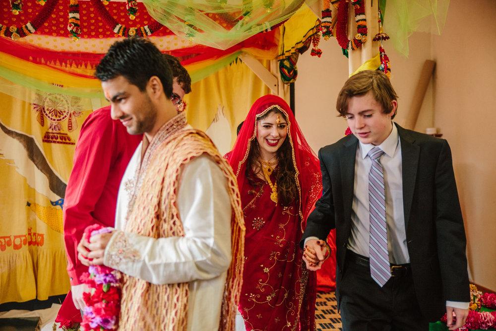 brides brother walks her in to wedding ceremony