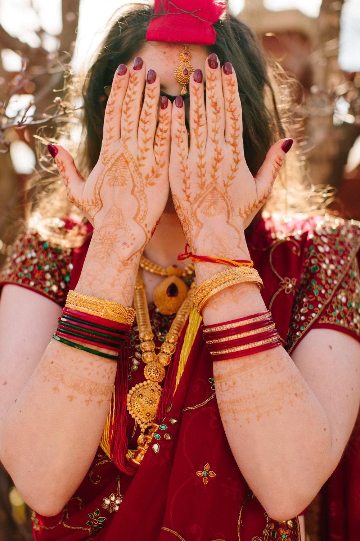 bride with henna on hands hindu nepali wedding