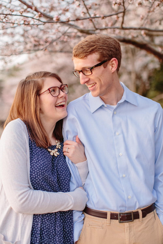 couple kissing cherry blossom engagement photos Washington DC tidal basin
