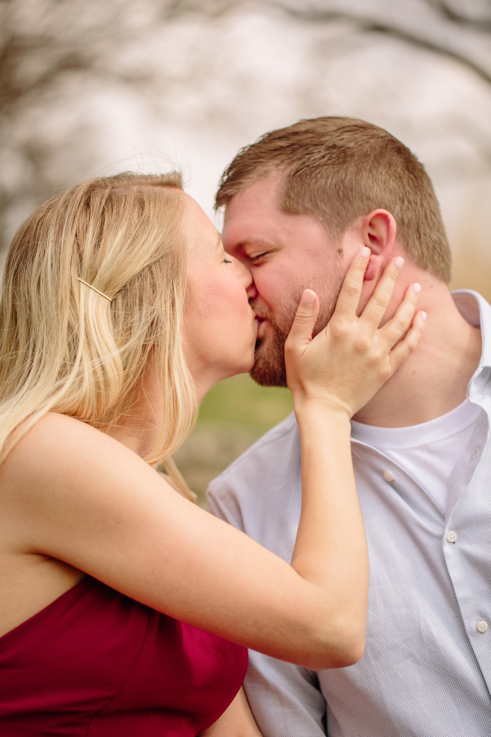 kissing with hands on face engagement photos Des Moines IOwa amelia renee