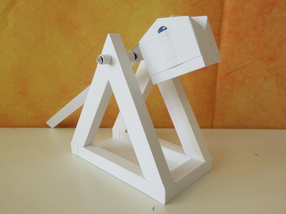 This trebuchet catapult was designed with 110lb cardstock to survive the forces of the counterweight and throwing arm!