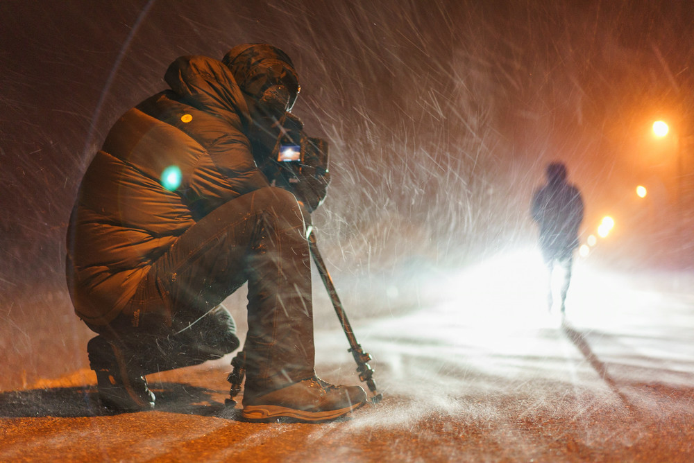 SmugMug Videographer Anton Lorimer follows Burkard as he walks through the hard blowing storm that welcomed the team.