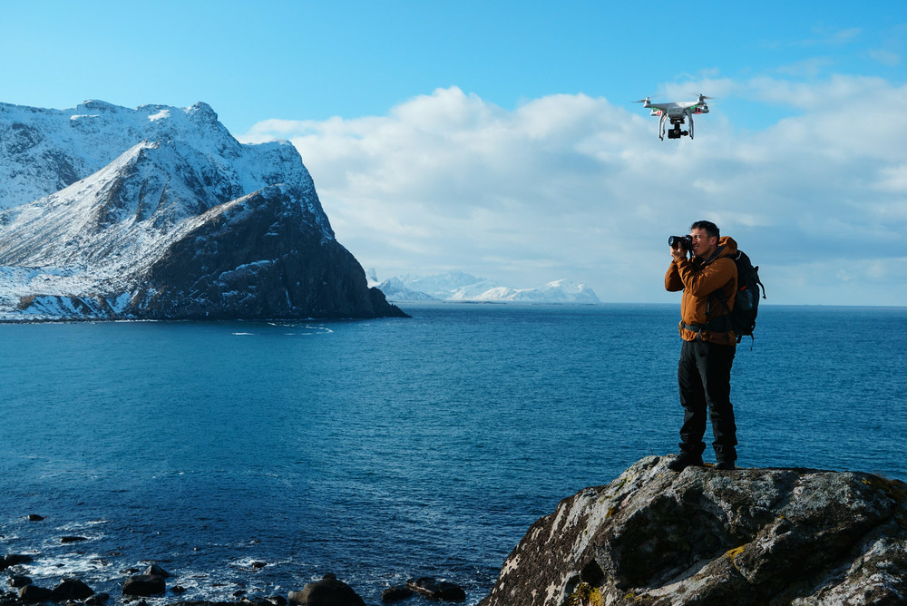 The DJI Phantom Drone hovers overhead as Chris captures a landscape photo.