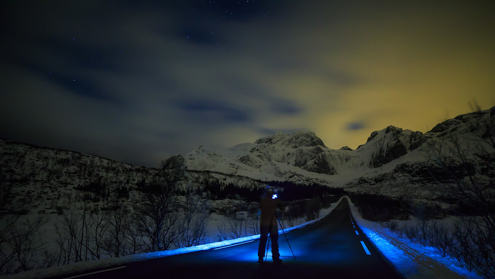 Chris' love for night Photography and empty roads intersect in the dark Arctic night.