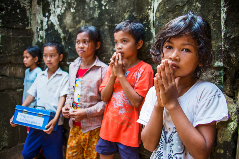 Children beg for money at a temple in Cambodia.