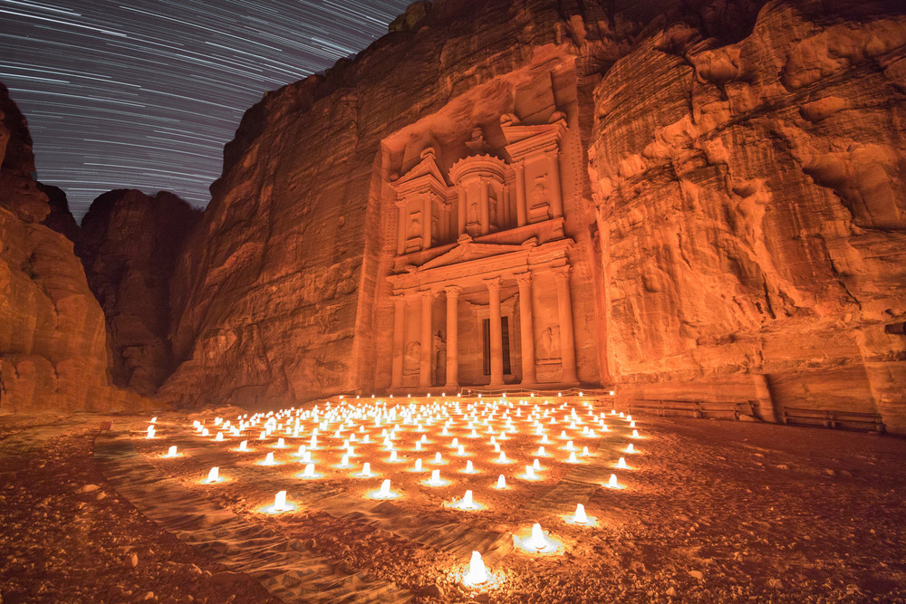The Treasury in Petra, Jordan is an incredible site at night, when it is illuminated by candlelight.