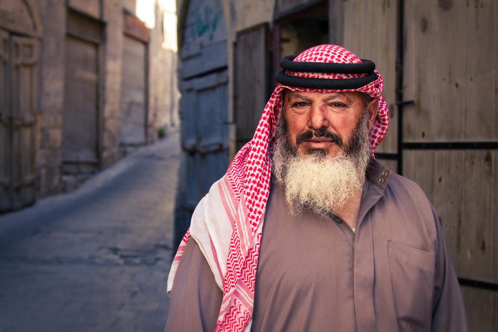 A merchant outside of a narrow ally way in Al-Salt, Jordan.