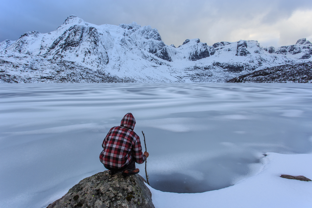 Brett Barley overlook  a frozen lake that we found on a road trip through the Lofoten Islands.